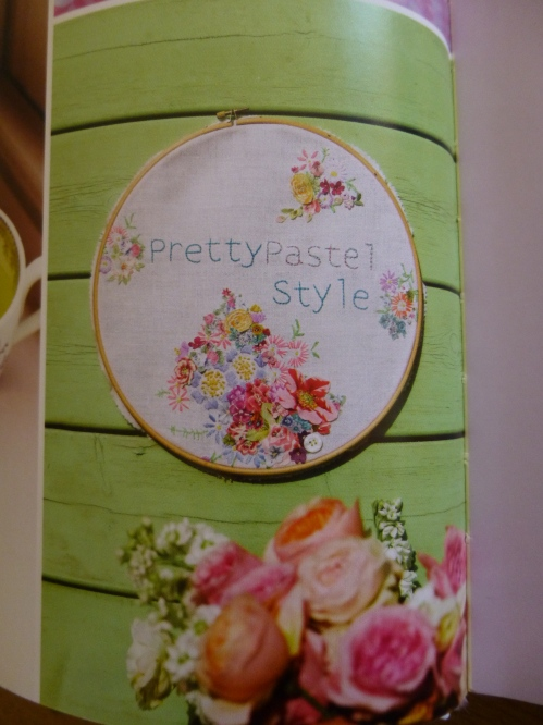 The lovely embroidered hoop is by Vicky Trainor